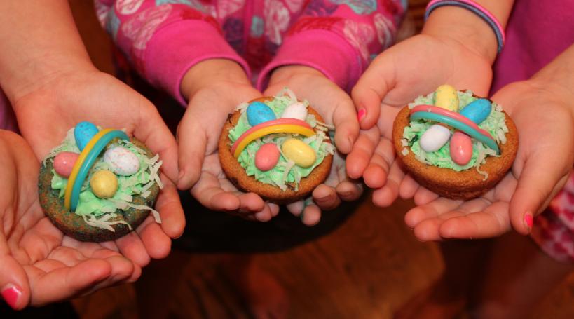 girls holding cupcakes