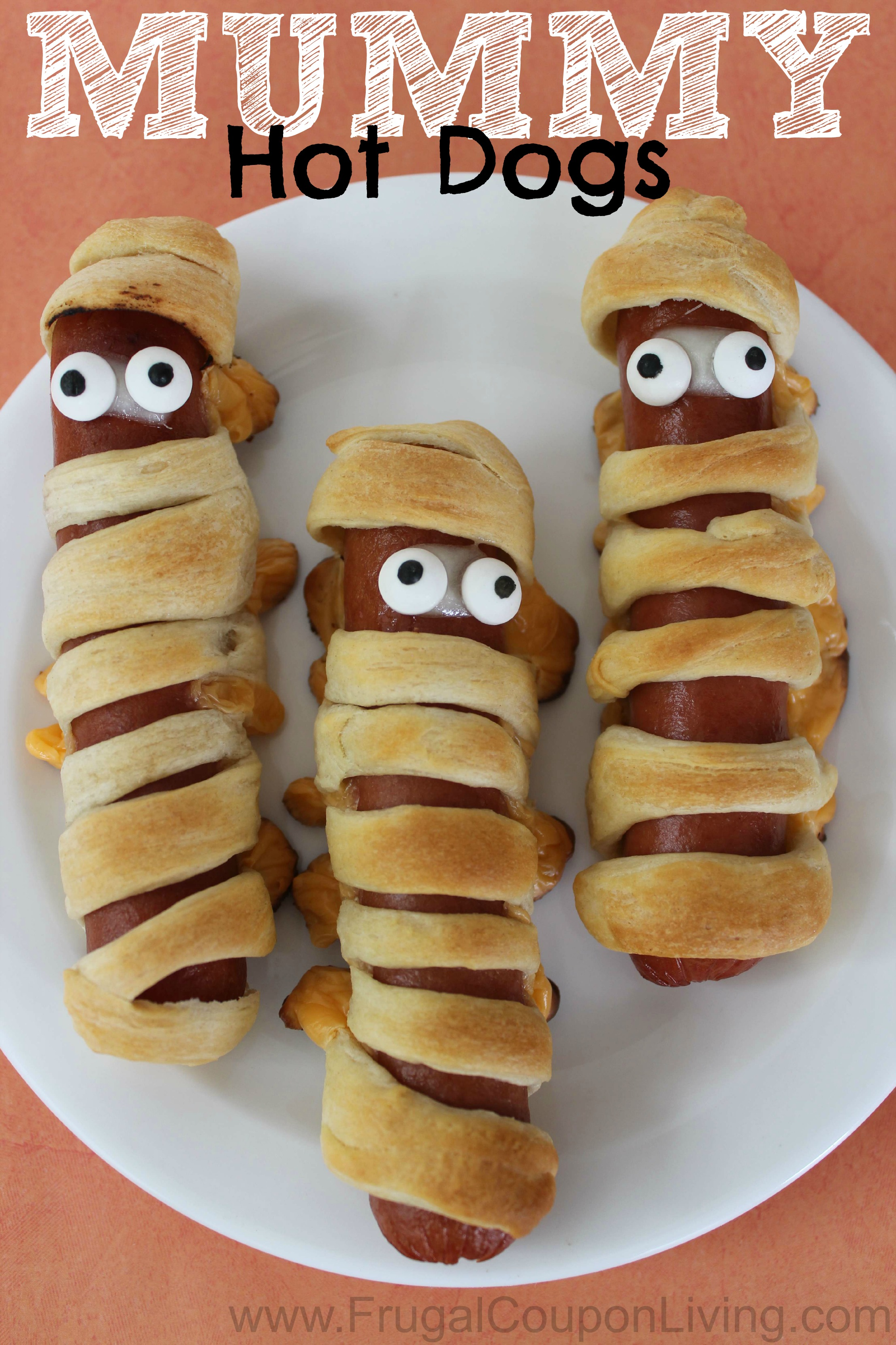 Halloween Mummy Hot Dogs using Crescent Rolls - these make a yummy Halloween Dinner. #mummyhotdogs #mummy #hotdogs #hotdogrecipe #halloween #halloweenrecipes #FrugalCouponLiving