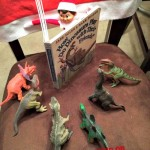 elf-on-the-shelf-ideas-elf-reads-to-dinos-frugal-coupon-living