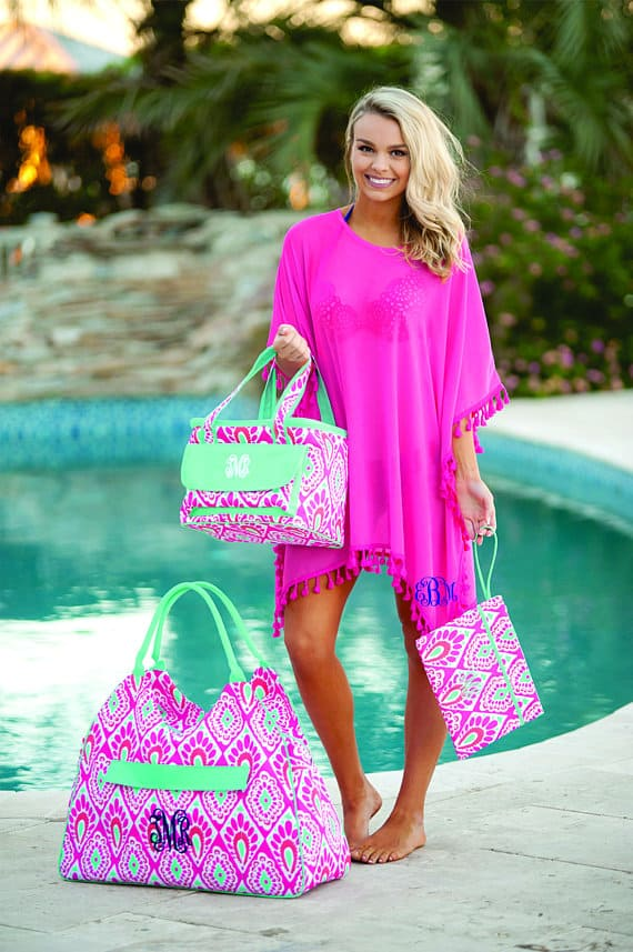 328ddc51d5 This one is for all of you who love pom poms. This Monogrammed Beach Cover- Up with pom poms is available in four colors for $17.