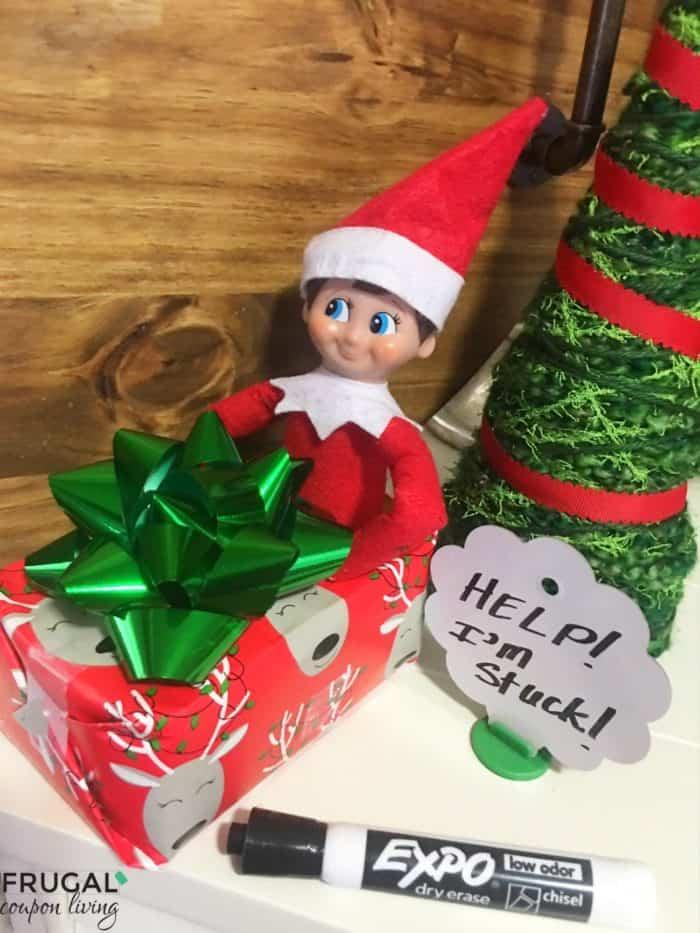 Elf got himself caught in a gift box! | Elves at Play Kit | Elf on the Shelf Ideas | Free Elf Printables #FrugalCouponLiving #ElfontheShelf #ElfontheShelfIdeas #ElfIdeas #funnyelfideas #funnyelfontheshelf #elfprintables #freeelfprintables #printables #freeprintables #elvesatplay