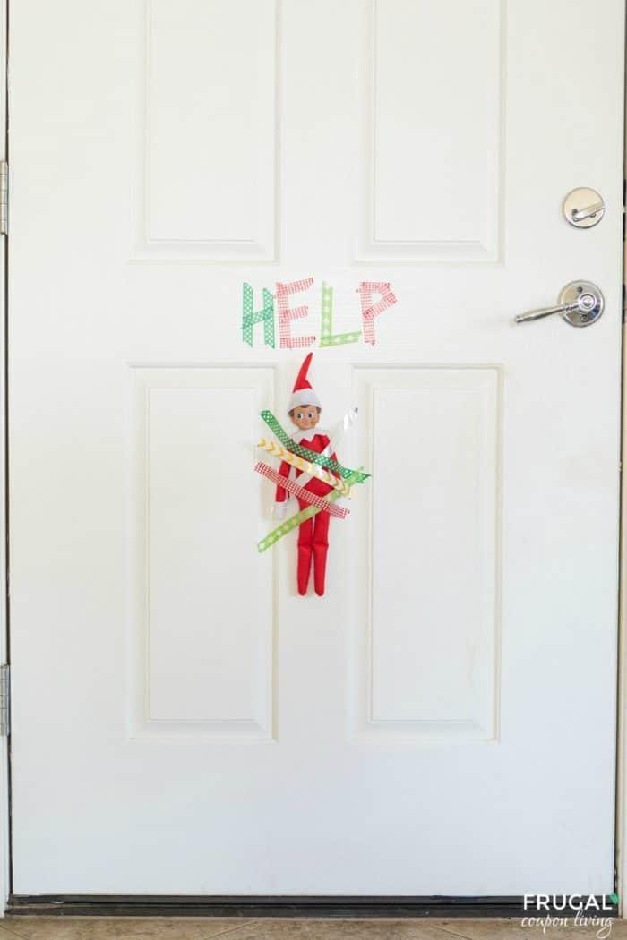 Help! Elf is taped to the door! #FrugalCouponLiving #ElfontheShelf #ElfontheShelfIdeas #ElfIdeas #funnyelfideas #funnyelfontheshelf #elfprintables #freeelfprintables #printables #freeprintables