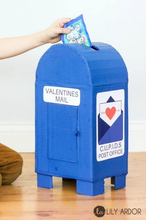 Here's a cute idea for a boy's Valentines Mailbox. See how it's made using cardboard and blue paint. This comes free Cupid's Post Office printable.