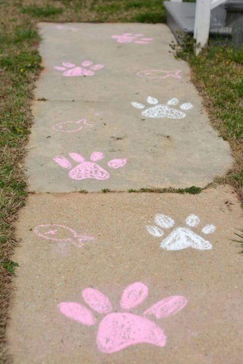 Sidewalk Chalk Art with paw prints - Cat Party Ideas